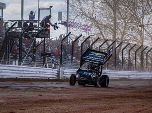Carson Macedo takes the checkered flag Sunday at Williams Grove Speedway. (Shawn Cooper Photo)