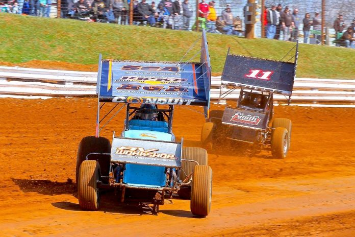 Lance Dewease fends off TJ Stutts (11) during an event at Williams Grove Speedway. (Dan Demarco photo)