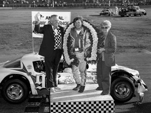 Hugh Deery (left) and Jody Deery (right) with Dick Trickle in victory lane after the 1978 National Short Track Championship.