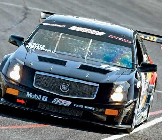 John Heinricy at the wheel of the Cadillac CTS-V.