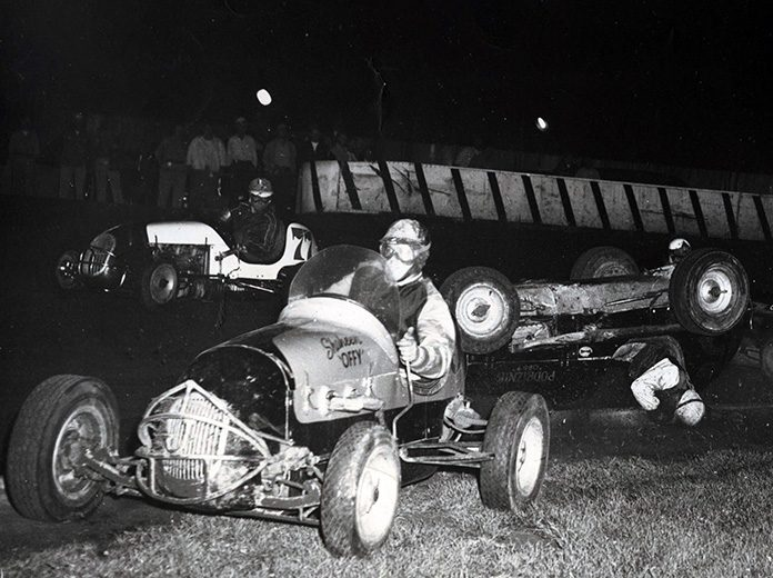 During his championship, Eddie Russo was involved in a high-speed flip at Raceway Park in early August of 1950. Rex Easton and Bud Koehler (77) try to stay out of the crash.