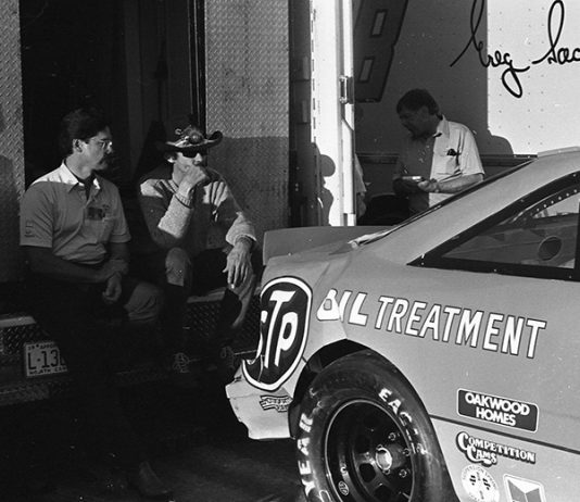 Richard Petty looks at the back of his damaged race car after failing to qualify for a NASCAR Cup Series race at Richmond Raceway in March of 1989. (Chris Economaki Photo)