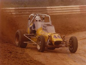 Note the wing mounts on the Bruce Cogle Ford sprinter. On this Sunday in 1975, Jones grabbed an afternoon USAC win at Terre Haute, hauled 90 miles to Haubstadt, IN, mounted a wing and won again that night. (Tom Dick Photo)