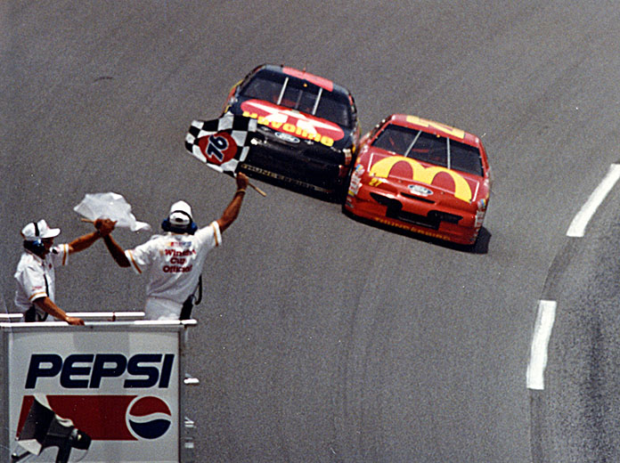 Jimmy Spencer (27) beats Ernie Irvan to the finish line to win the Pepsi 400 in 1994. (NASCAR Photo)