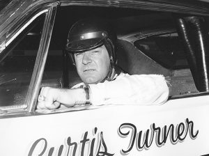 Curtis Turner sits in his race car in 1965. (NASCAR Photo)