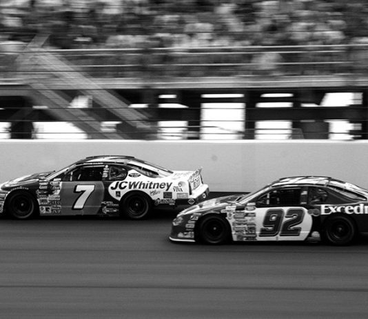 Jimmie Johnson (92) battles Randy LaJoie on July 14, 2001 at Chicagoland Speedway. Johnson went on to win the race, his first major NASCAR victory. (Sheryl Creekmore Photo)