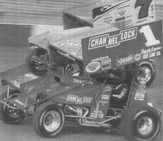 Sammy Swindell (1) races under Butch Schroeder during World of Outlaws action at Bristol (Tenn.) Motor Speedway in 2000. (Bob Hesser/NSSN Archives Photo)