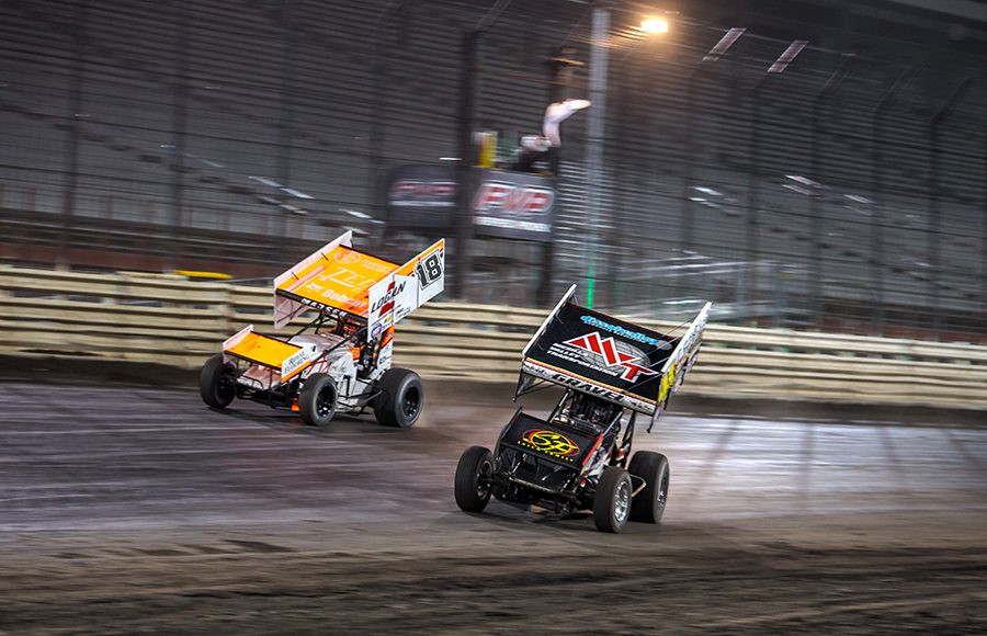 David Gravel (41) battles to the inside of Ian Madsen late in Friday's World of Outlaws NOS Energy Drink Sprint Car Series feature at Knoxville Raceway. (Trent Gower Photo)