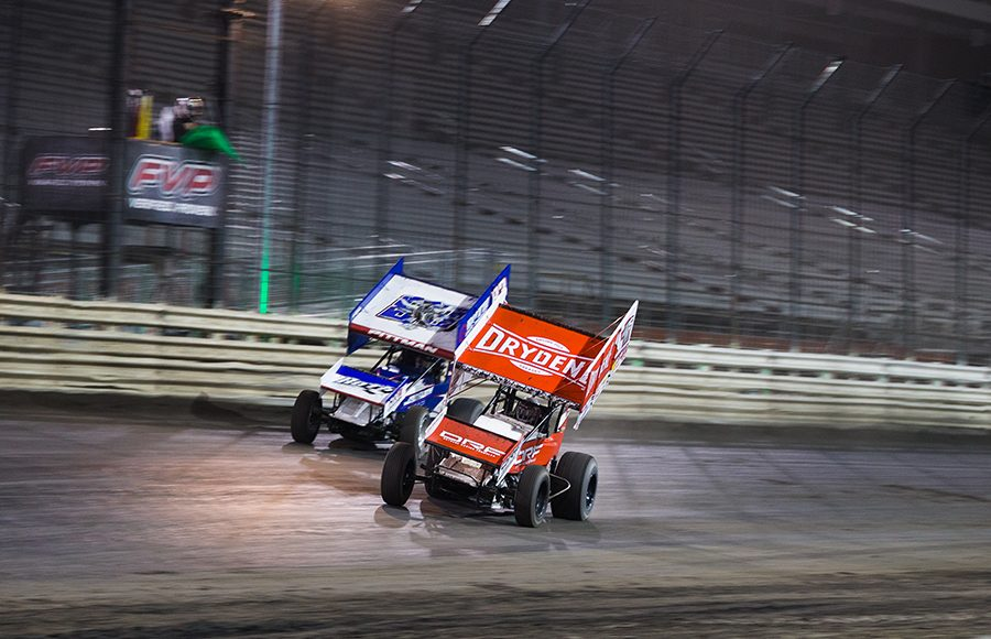 Logan Schuchart (1s) battles Daryn Pittman during Friday's World of Outlaws NOS Energy Drink Sprint Car Series feature at Knoxville Raceway. (Trent Gower Photo)