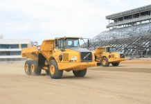 Jeg Coughlin Jr. and Mike Neff raced earthmovers during a press event prior to the opening of zMAX Dragway.