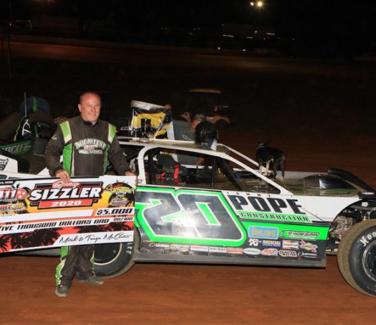 Jimmy Owens in victory lane Saturday night at 411 Motor Speedway. (Chad Wells Photo)