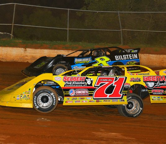 Hudson O'Neal (71) battles Kyle Strickler during Saturday's Spring Sizzler at 411 Motor Speedway. (Michael Moats Photo)