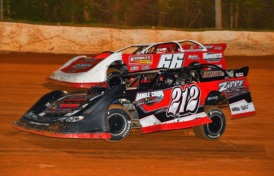 Josh Putnam (212) races under Jake Knowles during a heat race as part of Saturday's Spring Sizzler at 411 Motor Speedway. (Michael Moats Photo)