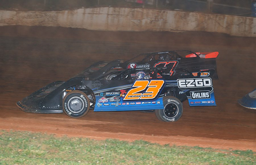 Cory Hedgecock (23) races under Josh Rice during Saturday's Spring Sizzler at 411 Motor Speedway. (Chad Wells Photo)