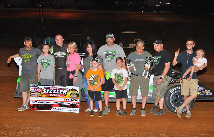 Jimmy Owens poses in victory lane after winning Saturday's Spring Sizzler at 411 Motor Speedway. (Michael Moats Photo)