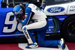 Chase Briscoe takes a moment to pray after winning Thursday's NASCAR Xfinity Series event at Darlington Raceway. (Getty Images Photo)