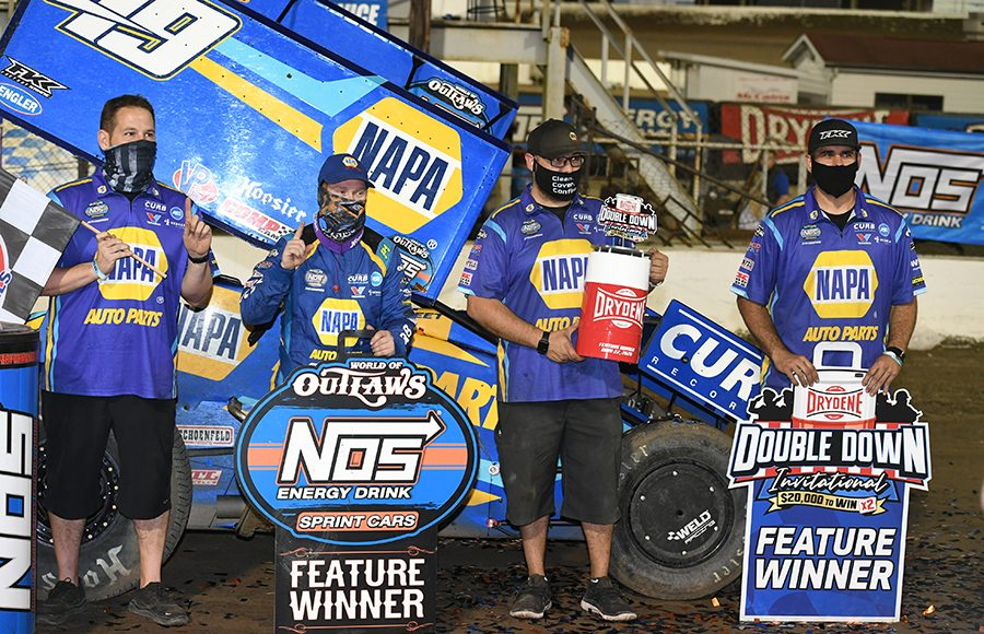 Brad Sweet and his crew pose in victory lane after winning Friday's World of Outlaws NOS Energy Drink Sprint Car Series feature at Federated Auto Parts Raceway at I-55. (Don Figler Photo)