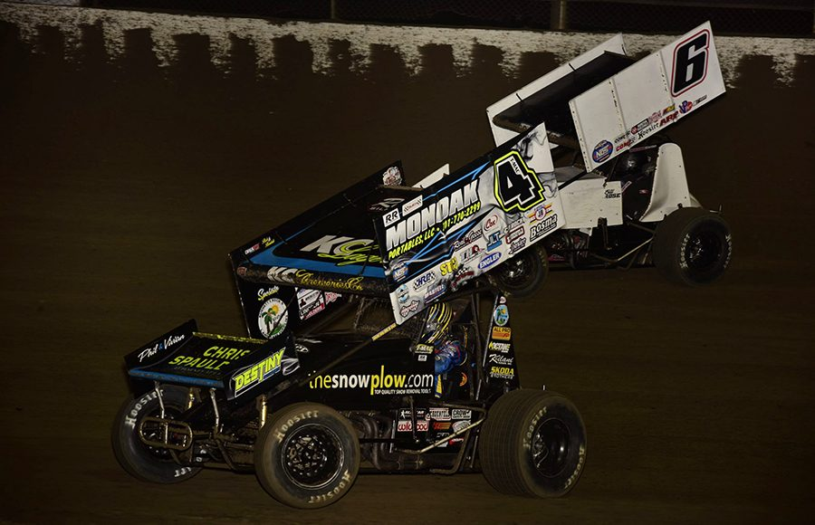 Terry McCarl (4) battles Bill Rose during Friday's World of Outlaws NOS Energy Drink Sprint Car Series event at Federated Auto Parts Raceway at I-55. (Mark Funderburk Photo)