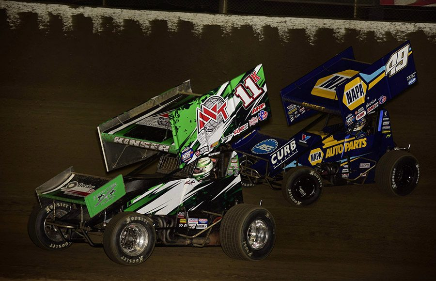 Kraig Kinser (11) races ahead of Brad Sweet during Friday's World of Outlaws NOS Energy Drink Sprint Car Series event at Federated Auto Parts Raceway at I-55. (Mark Funderburk Photo)