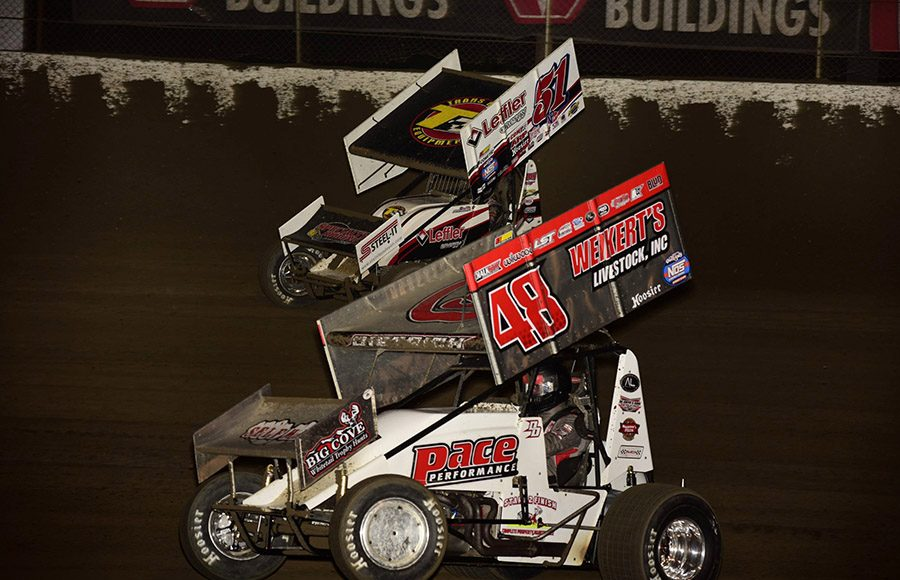 Danny Dietrich (48) races alongside Freddie Rahmer during Friday's World of Outlaws NOS Energy Drink Sprint Car Series event at Federated Auto Parts Raceway at I-55. (Mark Funderburk Photo)