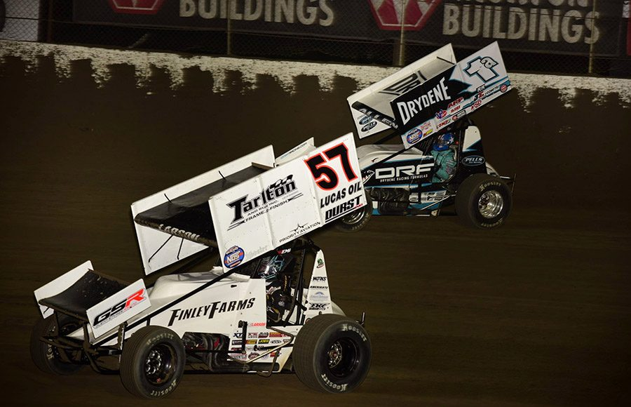 Kyle Larson (57) leads Jacob Allen during Friday's World of Outlaws NOS Energy Drink Sprint Car Series event at Federated Auto Parts Raceway at I-55. (Mark Funderburk Photo)