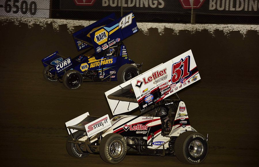 Freddie Rahmer (51) battles Brad Sweet during Friday's World of Outlaws NOS Energy Drink Sprint Car Series event at Federated Auto Parts Raceway at I-55. (Mark Funderburk Photo)