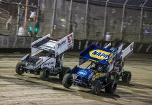 Brad Sweet (49) battles Kyle Larson (57) for the race lead during Friday's World of Outlaws NOS Energy Drink Sprint Car Series event at Federated Auto Parts Raceway at I-55. (Brad Plant Photo)