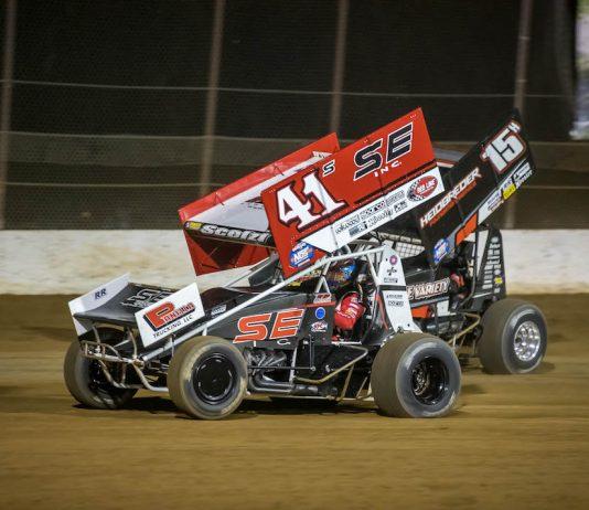 Dominic Scelzi (41) races under Sam Hafertepe Jr. at Lake Ozark Speedway. (Brad Plant photo)