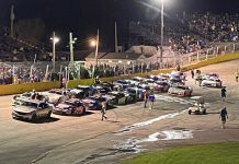Cars line up on the frontstretrch prior to Sunday's season opener at Slinger Super Speedway. (Nick Dettmann Photo)