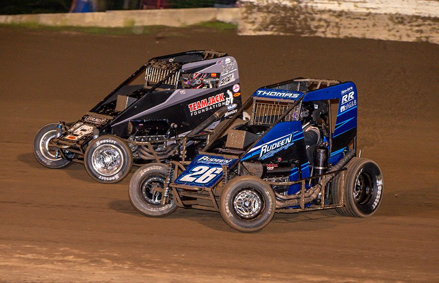 Tristin Thomas (26) battles Don Droud Jr. during Saturday's POWRi Lucas Oil National and West Midget League feature at Valley Speedway. (Mark Coffman Photo)