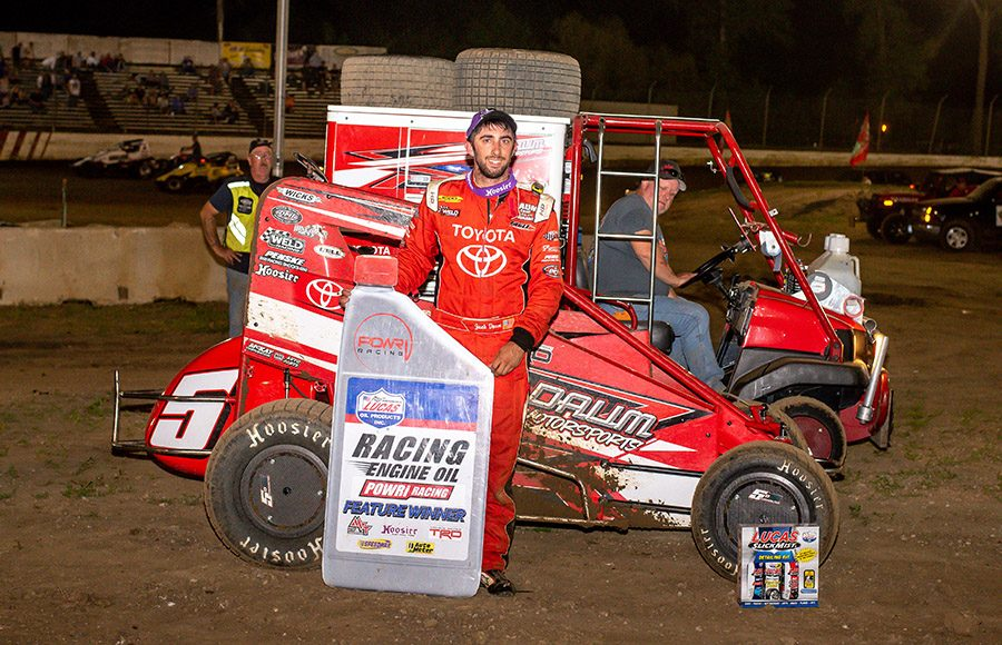 Zach Daum poses in victory lane after winning Saturday's POWRi Lucas Oil National and West Midget League feature at Valley Speedway. (Mark Coffman Photo)