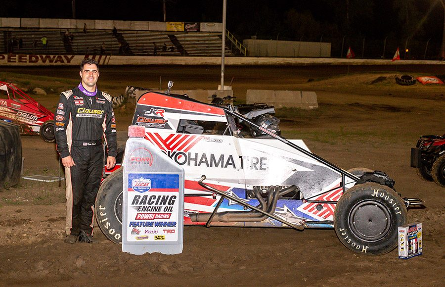 Mario Clouser poses in victory lane after winning Saturday's POWRi Lucas Oil WAR Sprint League feature at Valley Speedway. (Mark Coffman Photo)