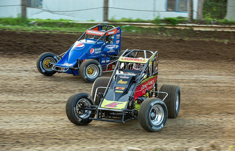 Braydon Cromwell (4) and Nate McMillin battle for position during a POWRi Lucas Oil WAR Sprint League heat race on Saturday at Valley Speedway. (Russell Moore Photo)