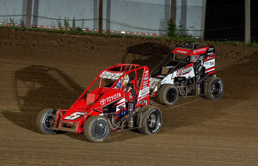 Zach Daum (5d) leads Emerson Axsom during Saturday's POWRi Lucas Oil National and West Midget League event at Valley Speedway. (Russell Moore Photo)