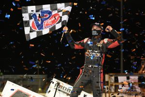 Kyle Larson celebrates after his $20,000 World of Outlaws NOS Energy Drink Sprint Car Series triumph on Saturday at Federated Auto Parts Raceway at I-55. (Don Figler Photo)