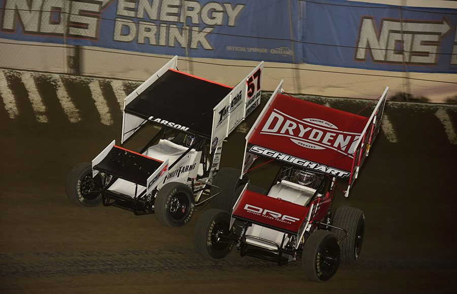 Logan Schuchart (1s) races under Kyle Larson during Saturday's World of Outlaws NOS Energy Drink Sprint Car Series feature at Federated Auto Parts Raceway at I-55. (Mark Funderburk Photo)