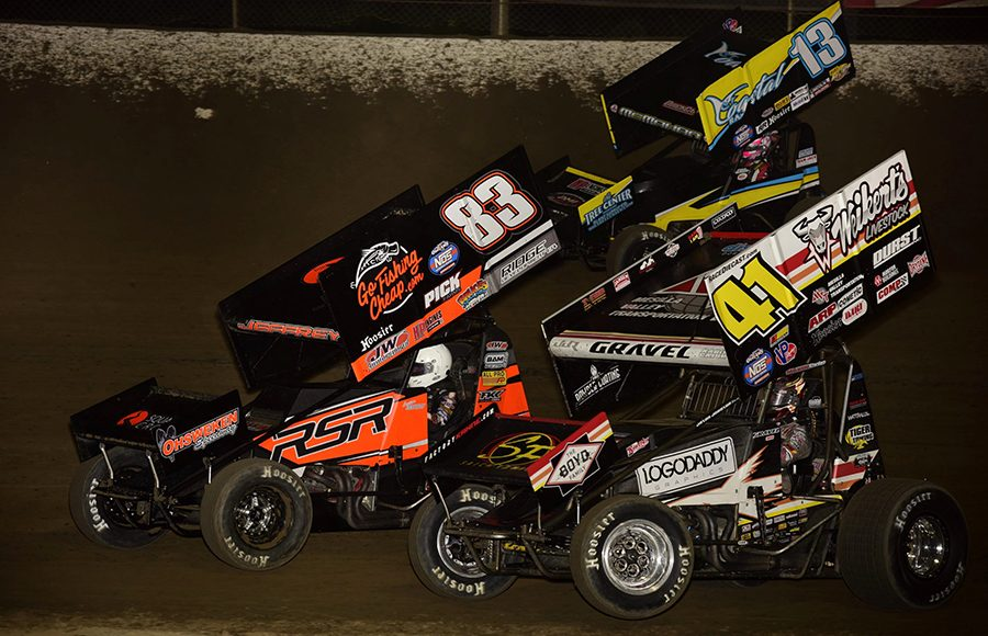 David Gravel (41), Lynton Jeffrey (83) and Paul McMahan battle for position during Saturday's World of Outlaws NOS Energy Drink Sprint Car Series feature at Federated Auto Parts Raceway at I-55. (Mark Funderburk Photo)