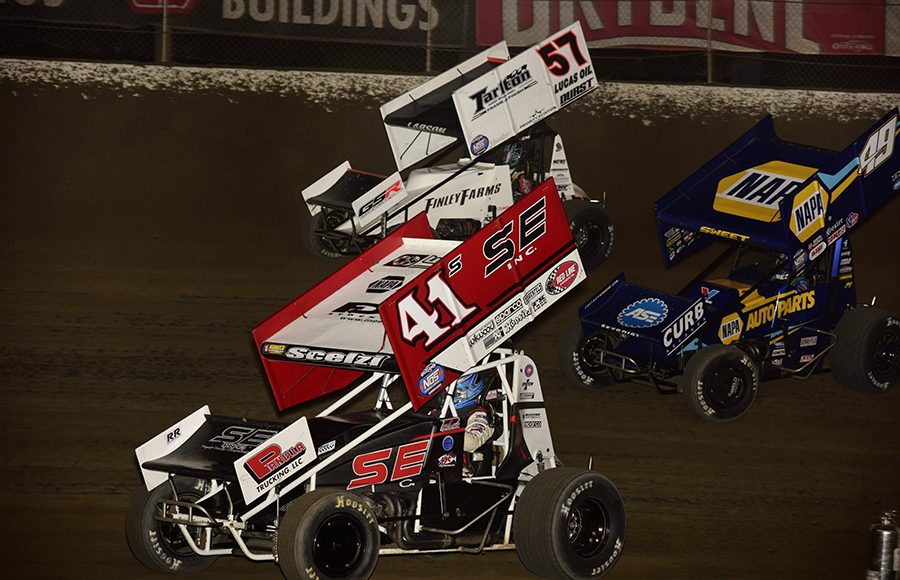 Dominic Scelzi (41), Kyle Larson (57) and Brad Sweet battle during Saturday's World of Outlaws NOS Energy Drink Sprint Car Series feature at Federated Auto Parts Raceway at I-55. (Mark Funderburk Photo)