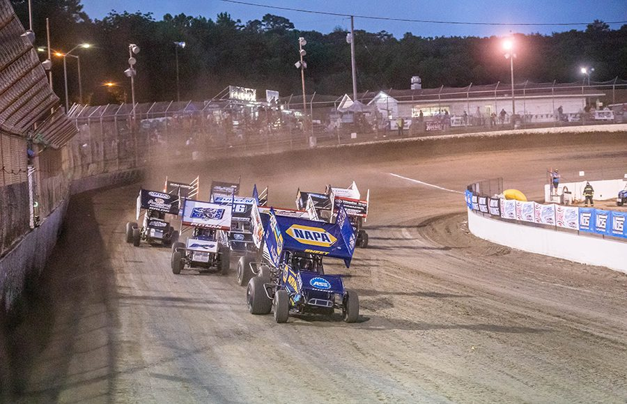 Brad Sweet (49) leads a pack of cars during preliminary competition as part of Saturday's World of Outlaws NOS Energy Drink Sprint Car Series event at Federated Auto Parts Raceway at I-55. (Brad Plant Photo)