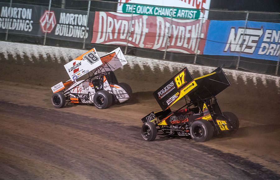Ian Madsen (18) leads Aaron Reutzel through a turn during Saturday's World of Outlaws NOS Energy Drink Sprint Car Series feature at Federated Auto Parts Raceway at I-55. (Brad Plant Photo)
