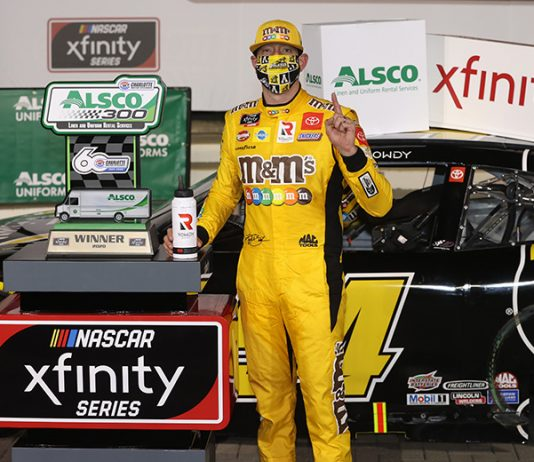 Kyle Busch stands in victory lane after his victory Monday night at Charlotte Motor Speedway. (Chris Graythen/Getty Images Photo)