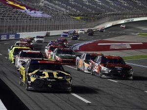 Kyle Busch (54) leads the field late in Monday's NASCAR Xfinity Series Alsco 300 at Charlotte Motor Speedway. (Jared C. Tilton/Getty Images Photo)