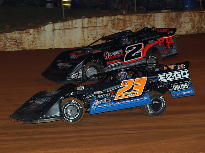 Cory Hedgecock (23) races under Nick Hoffman on Monday night at 411 Motor Speedway. (Chad Wells Photo)