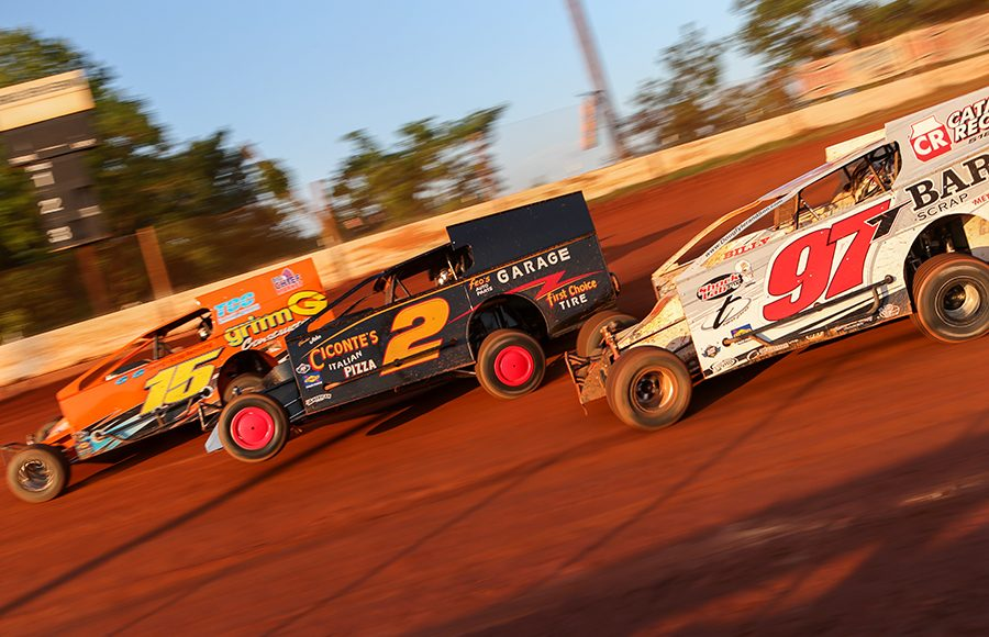 Brett Tonkin (15), Mike Franz (2) and Danny Tyler battle during Short Track Super Series preliminary action on Saturday at Cherokee Speedway. (Adam Fenwick Photo)