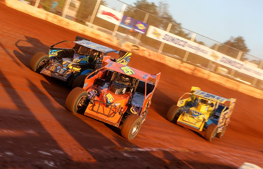 Brett Tonkin (15) races ahead of Billy Decker (91) and Billy Pauch Jr. during Short Track Super Series preliminary action on Saturday at Cherokee Speedway. (Adam Fenwick Photo)