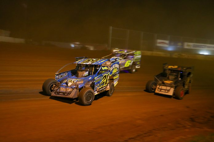 Kyle Weiss (21k) leads Mike Franz (2) and J.R. Hulbert during Short Track Super Series preliminary action on Saturday at Cherokee Speedway. (Adam Fenwick Photo)