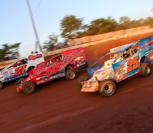 Peter Britten (21a), Larry Wight (99) and Erick Rudolph race three-wide during Short Track Super Series preliminary action on Saturday at Cherokee Speedway. (Adam Fenwick Photo)