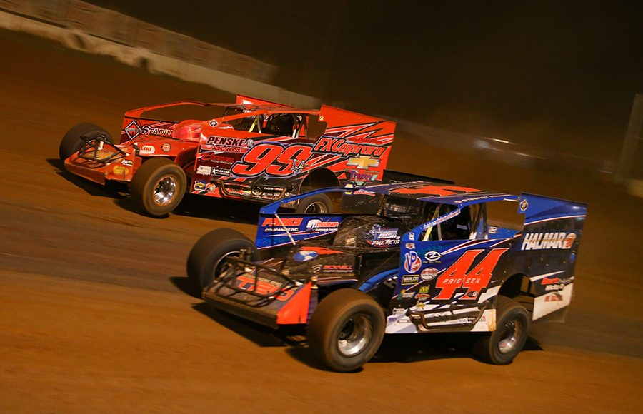 Stewart Friesen (44) races under Larry Wight in a battle for the race lead during Saturday's Short Track Super Series feature at Cherokee Speedway. (Adam Fenwick Photo)
