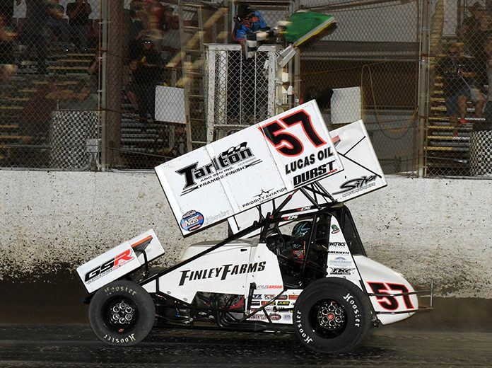 Kyle Larson takes the checkered flag Saturday night at Federated Auto Parts Raceway at I-55. (Don Figler Photo)