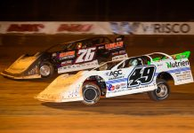 Brandon Overton (76) and Jonathan Davenport, shown at Golden Isles Speedway, battled for the victory Tuesday at East Bay Raceway Park. (Heath Lawson photo)